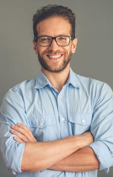 Handsome young businessman in shirt and eyeglasses.